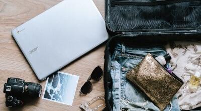 Article thumbnail - laptop & suitcase