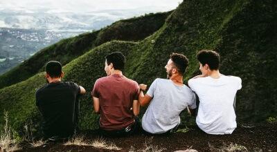 Article thumbnail - men on a cliff